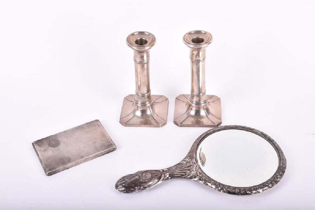 A pair of silver candlesticks  Birmingham 1939, by S.