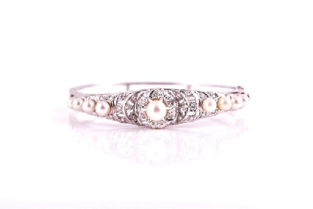A white metal, diamond, and pearlbracelet  the