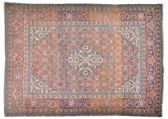 An Eastern Tabriz rug designed with a central cream