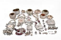 An unusual group of white metal items including
