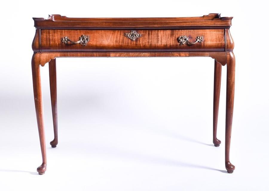 A Georgian mahogany veneer silver table   the
