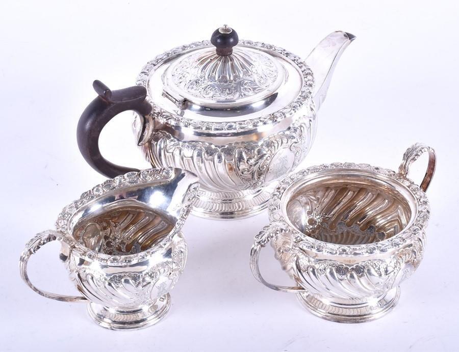 A late Victorian three piece silver bachelor's tea set
