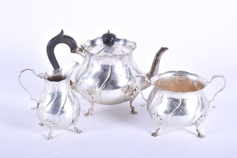 A consolidated late Victorian three-piece silver tea
