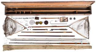 An early 20th century oak fishing rod and tackle box