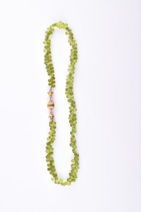 A faceted peridot bead necklace  comprised of