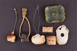 Seven small items of carved Chinese jade modelled