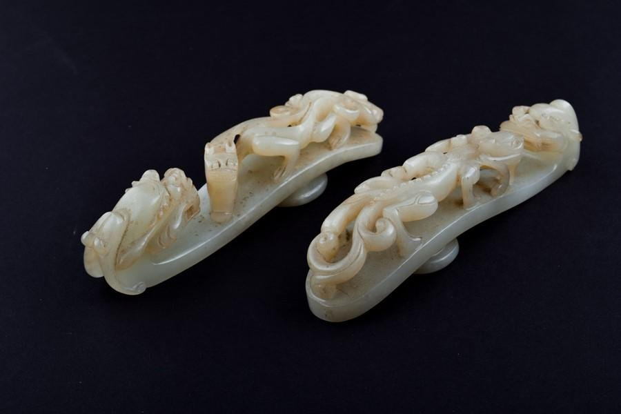 Two Chinese celadon jade belt buckles  each with of