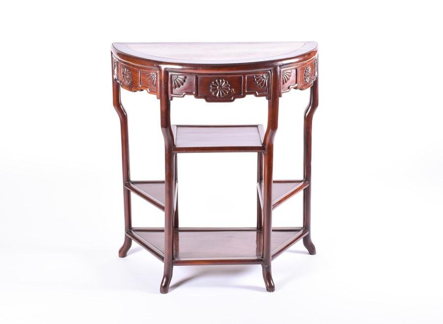 A Chinese late Qing dynasty hardwood three tier table