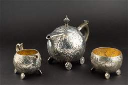 A Victorian silver Aesthetic style three piece tea set