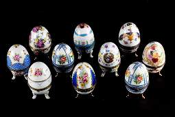 A collection of eight porcelain egg trinket boxes to