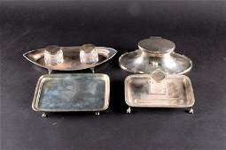 A George V silver capstan inkwell of elongated oval