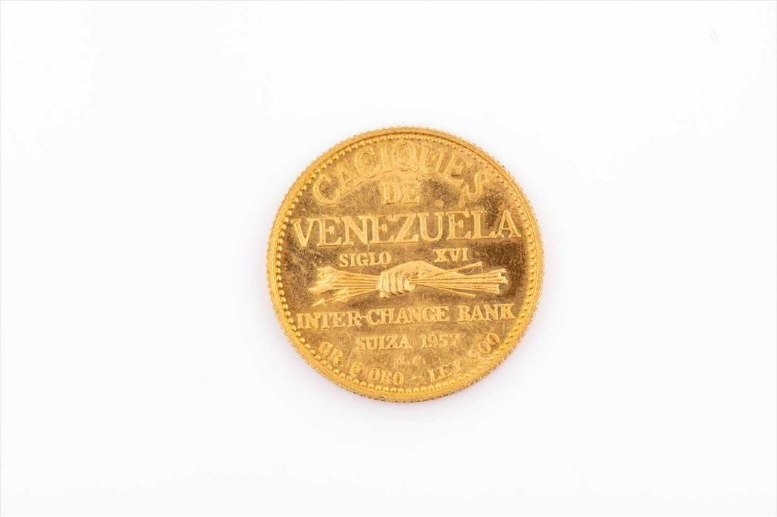 A 'Caciques de Venezuela' gold coin dated 1957.