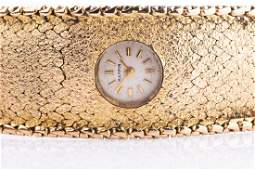 A 9ct yellow gold ladies bracelet watch the articulated