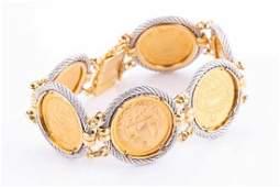 A yellow metal Iranian coin bracelet set with six half