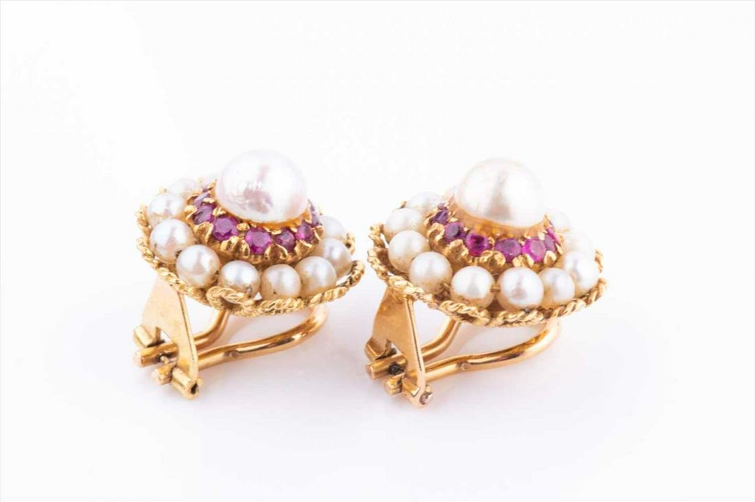 A pair of yellow metal, pearl, and ruby cluster