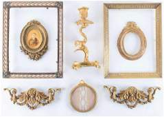 A small group of French gilt metal mounts and frames to