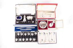 A mixed collection of cased 20th century silver items