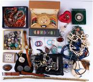 A large group of costume jewellery to include various
