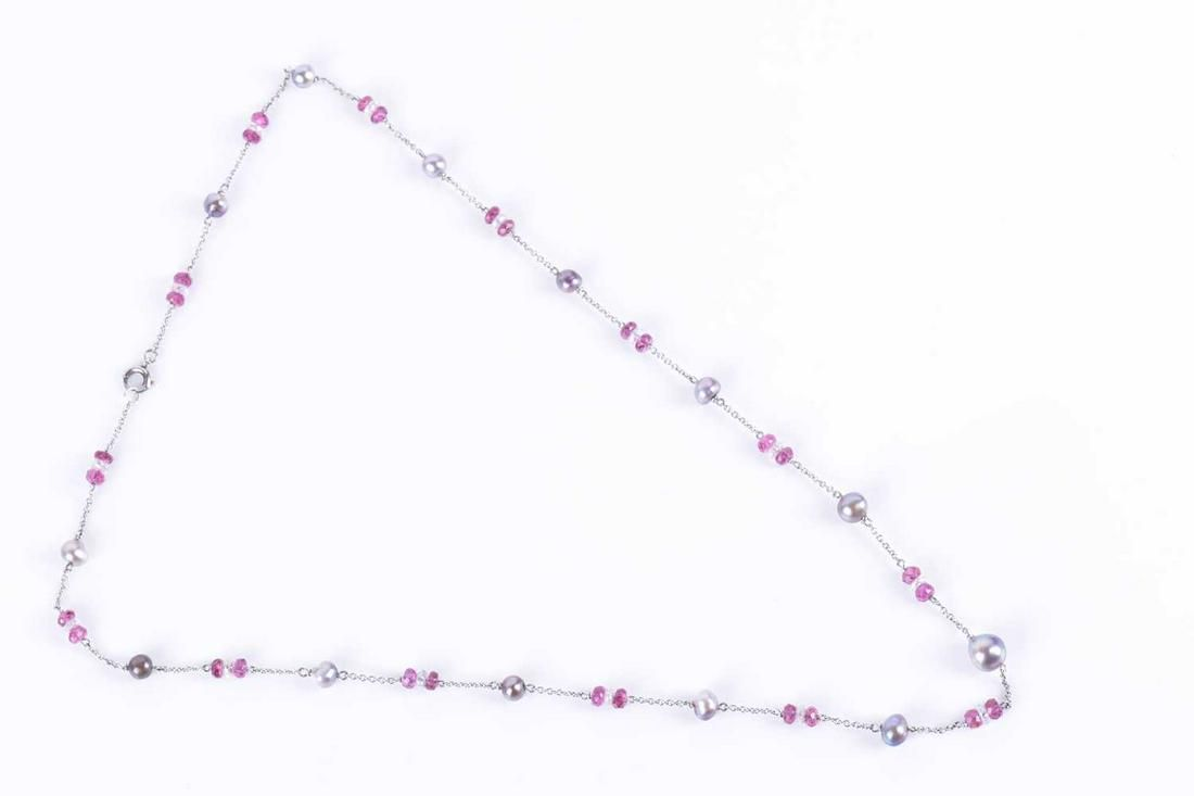 A platinum, diamond, pink tourmaline, and natural