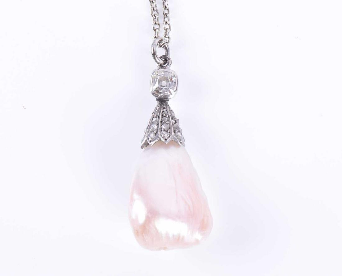 A natural freshwater pearl and diamond pendant the