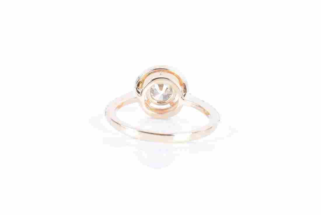A 14ct yellow gold and diamond halo ring centred with a