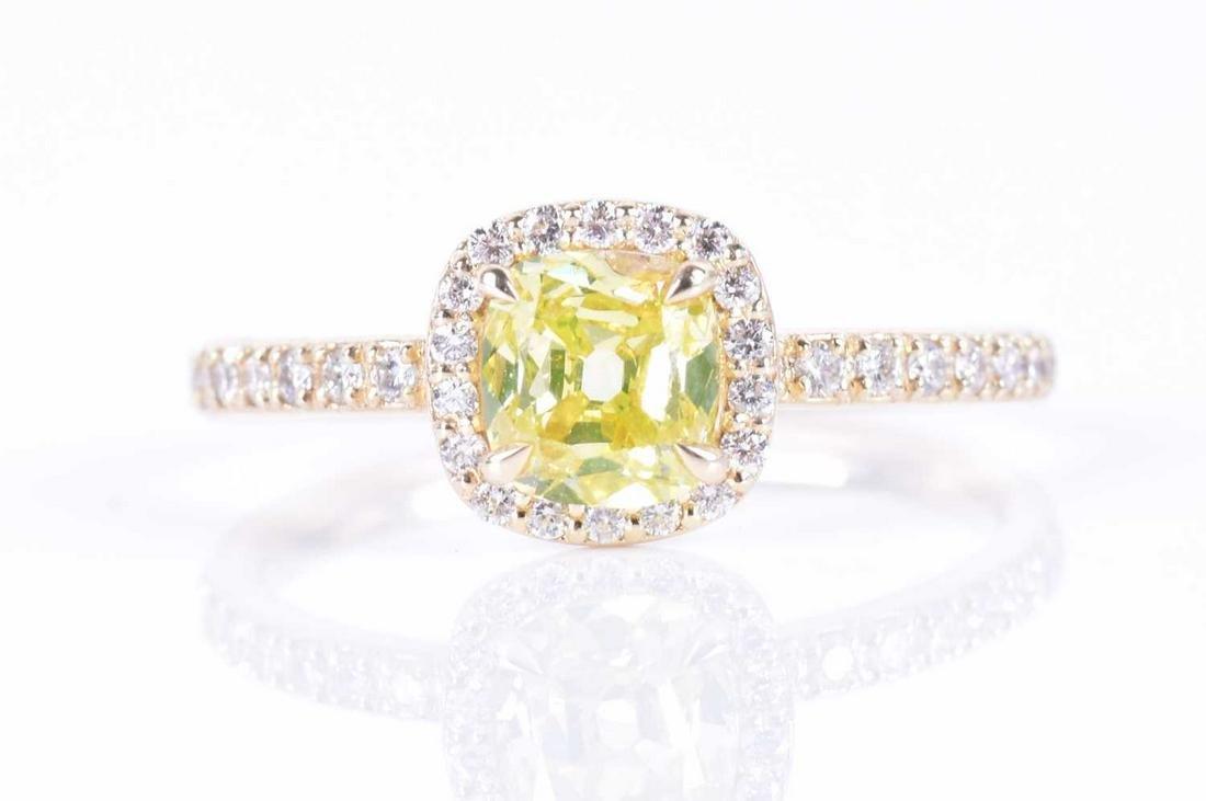 § A loose cushion-cut diamond of 0.43 carats, natural