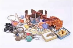 A group of costume jewellery items including copper