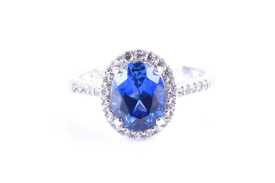 A white gold, white sapphire and blue stone ring set