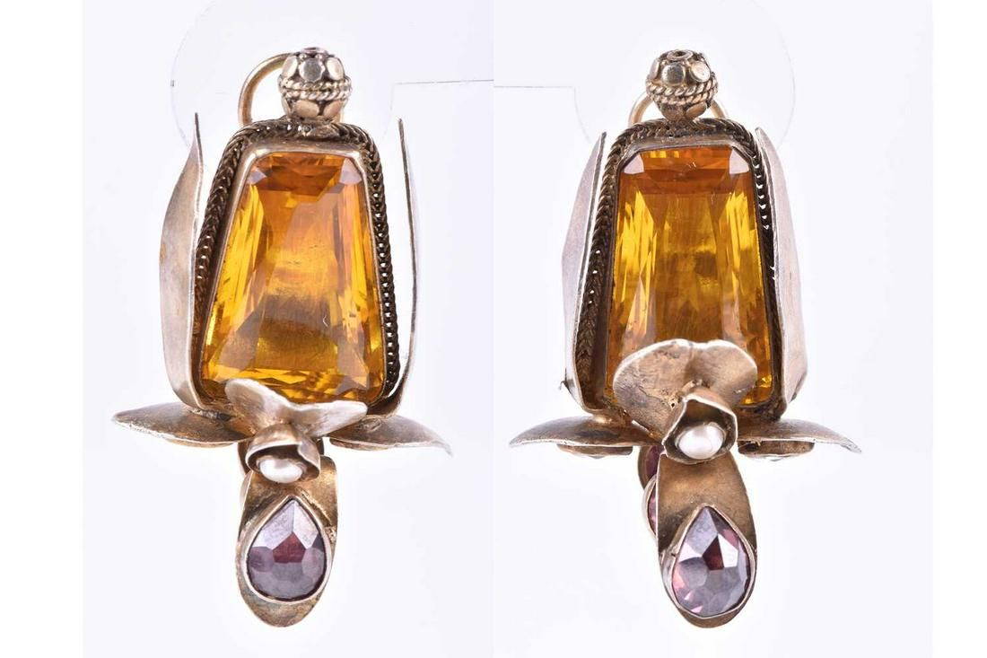 A pair of silver gilt and gemstone earrings the unusual