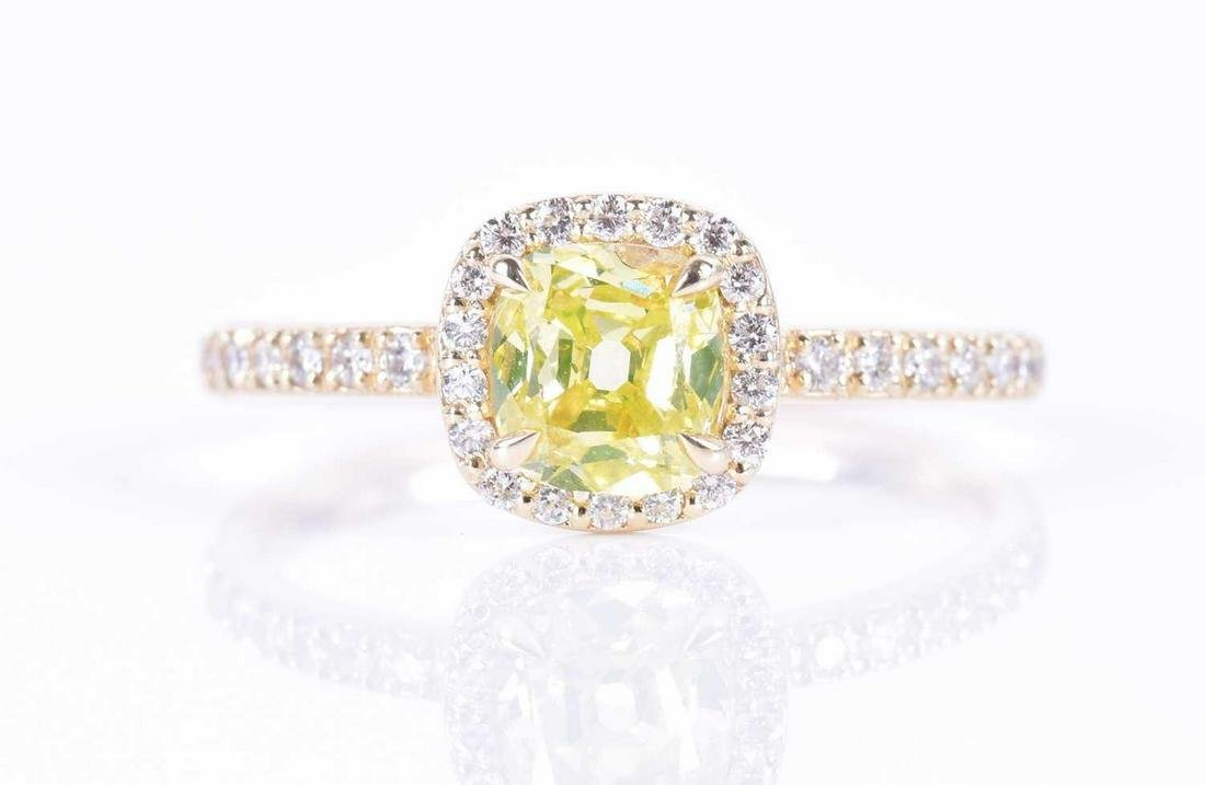 A 14ct yellow gold and yellow diamond halo ring set