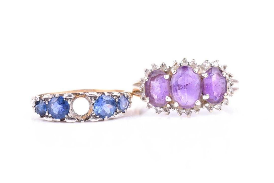 A 9ct yellow gold and amethyst ring, set with three