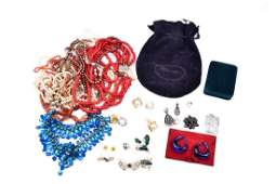 A group of costume jewellery items to include various
