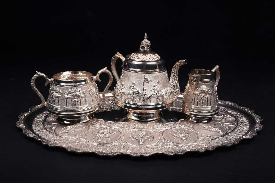 An Indian white metal three-piece teaset and conforming
