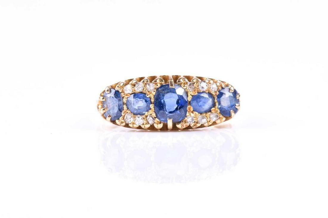An Edwardian sapphire and diamond 18ct gold five stone