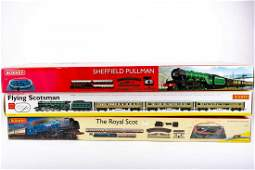 Three boxed Hornby 00 Gauge train sets comprising