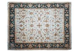 A large ivory ground Zeigler style Eastern carpet with