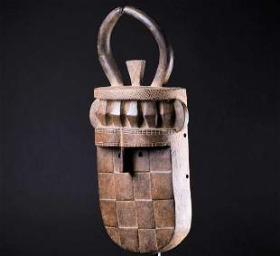 A Baule carved wood mask, Ivory Coast, with two horns