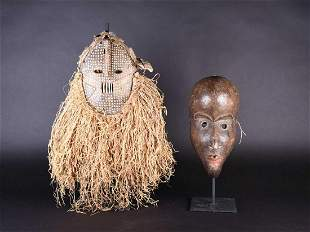 Two West African masks, possibly Dan, Ivory Coast, a