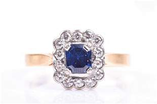 An 18ct yellow gold, diamond, and sapphire cluster