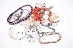 A group of costume jewellery items, including a small