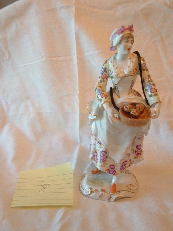 1008: Meissen figurine (Lady with basket)