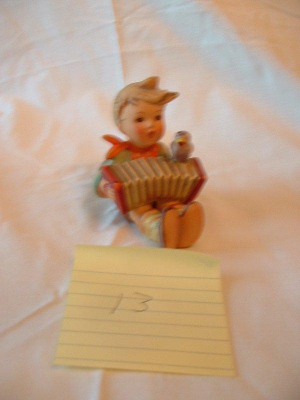 1013: Hummel Figurine (boy with according sitting)