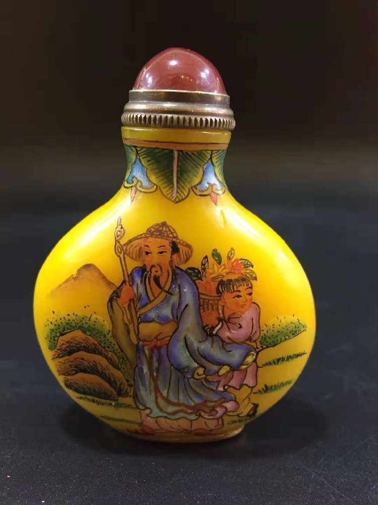 Hand-painted snuff bottle with glass sleeve