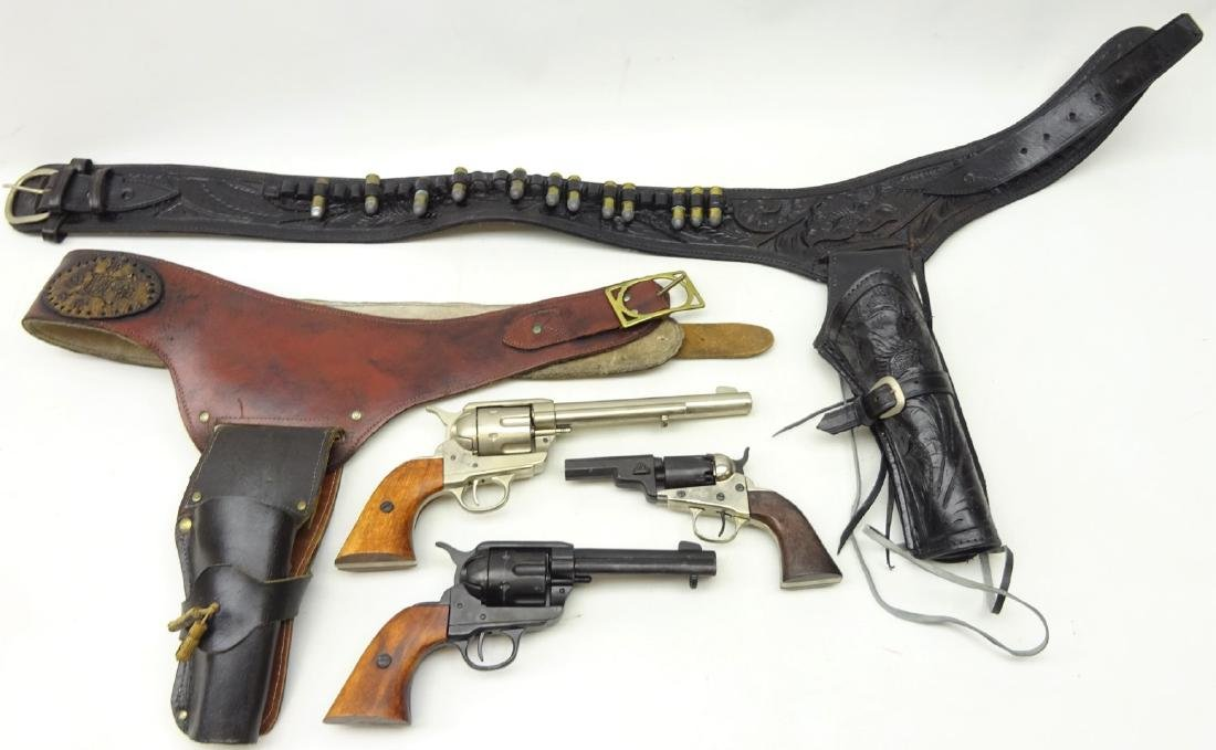 Two replica American Wild West revolvers in leather