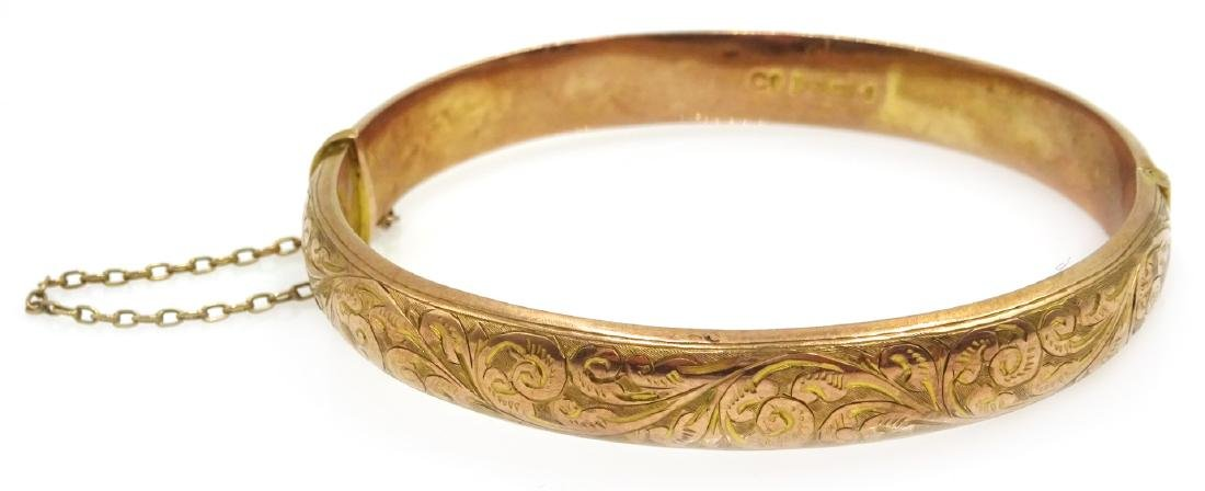 9ct rose gold hinged bangle, scroll decoration Chester