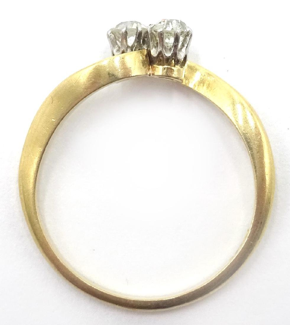 18ct gold diamond cross-over ring stamped 18ct