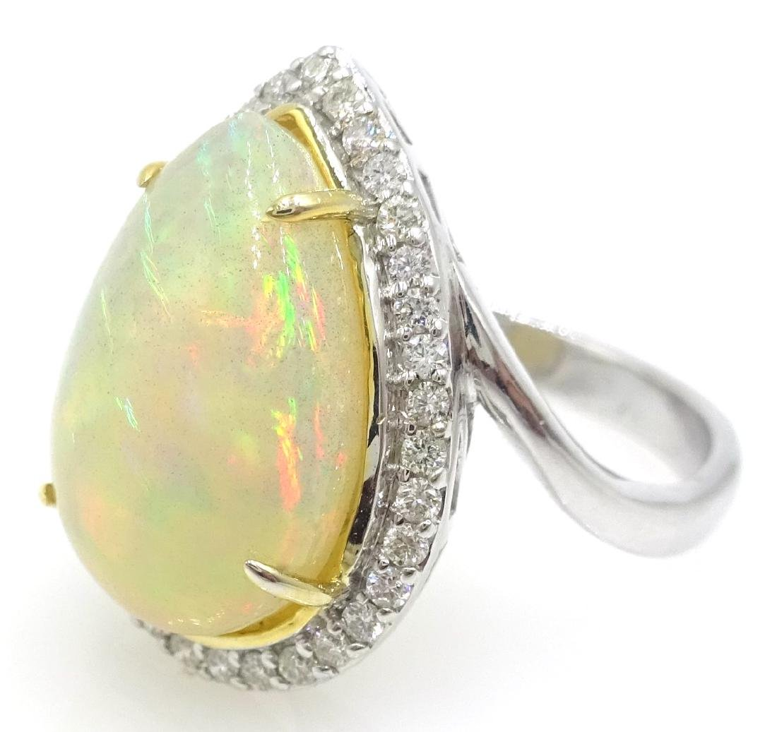 18ct white gold pear shaped opal and diamond cluster