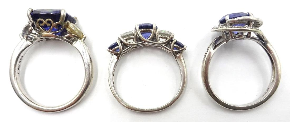 Three silver blue stone dress rings stamped 925 - 2