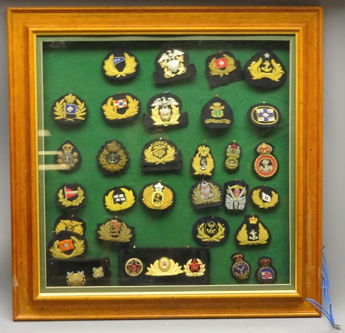 Collection of Merchant Navy and other cap badges mostly