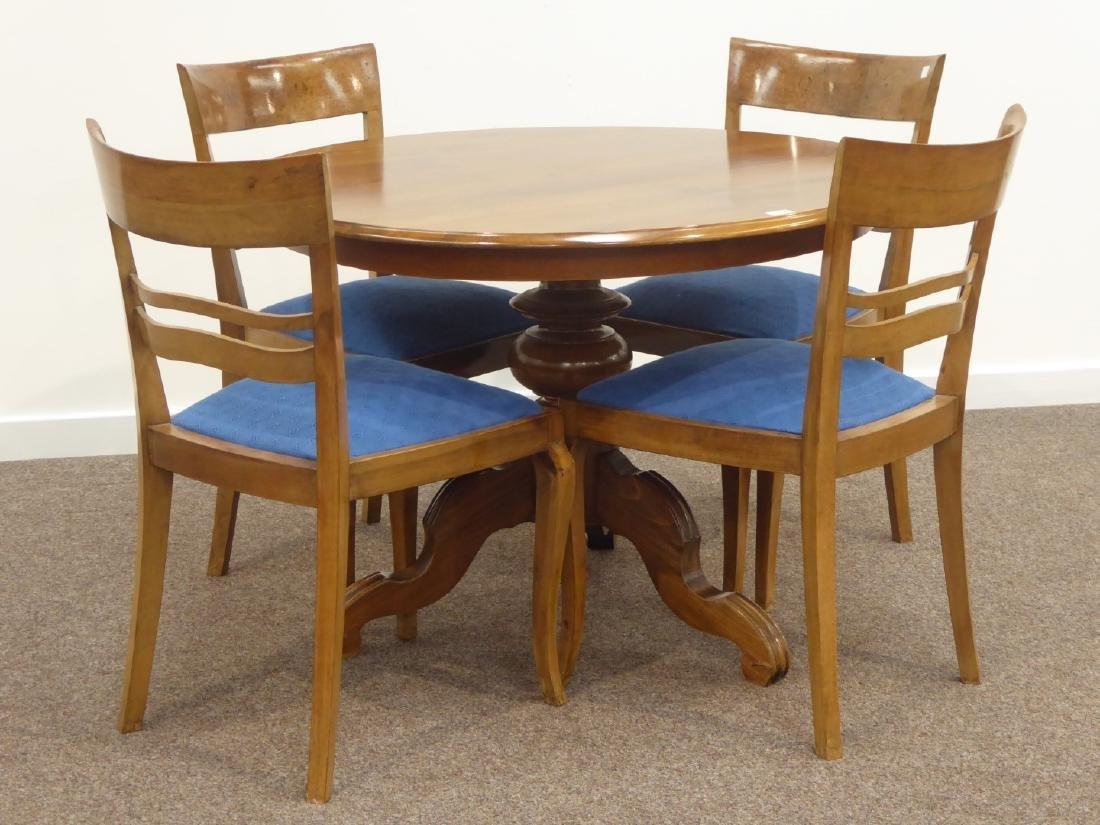 Circular walnut top dining table on turned pedestal